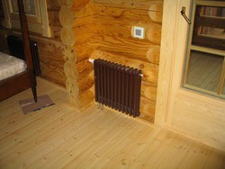 Деревянный коттедж в Подмосковье с радиатором Zehnder